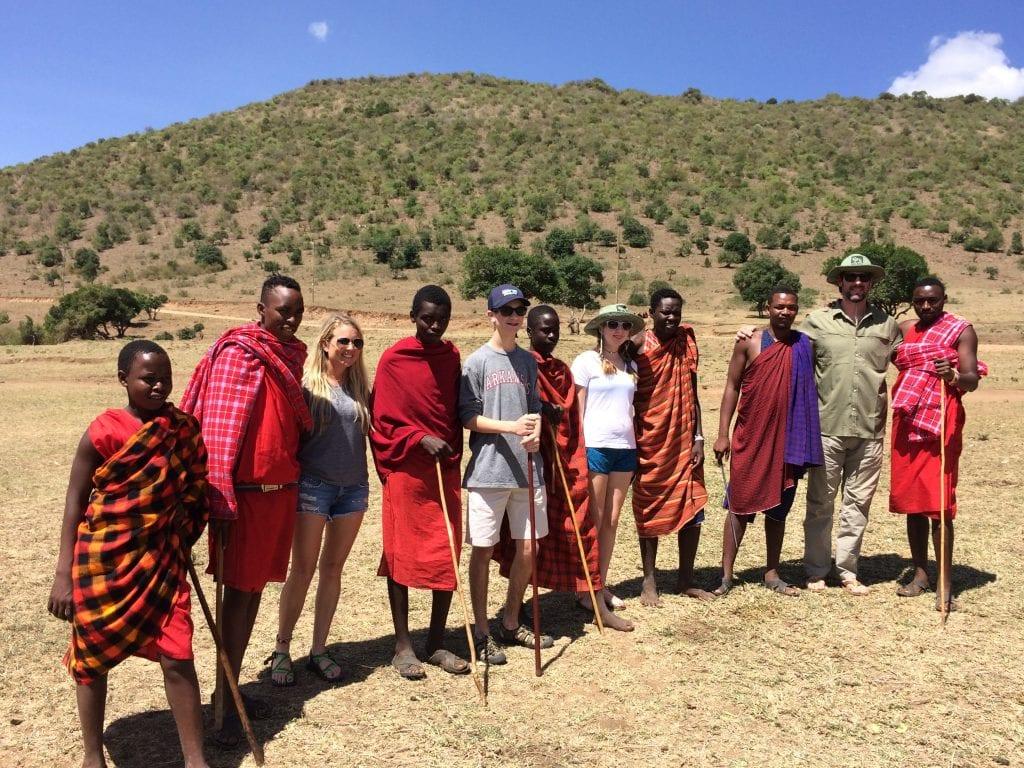 Maasai tribe with a family on safari