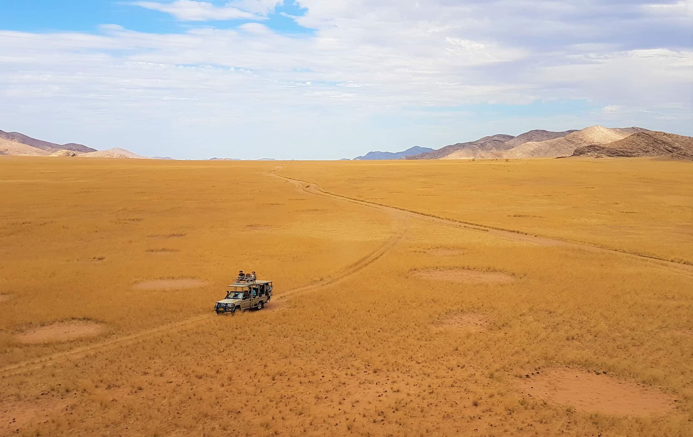 A car driving through a desert.
