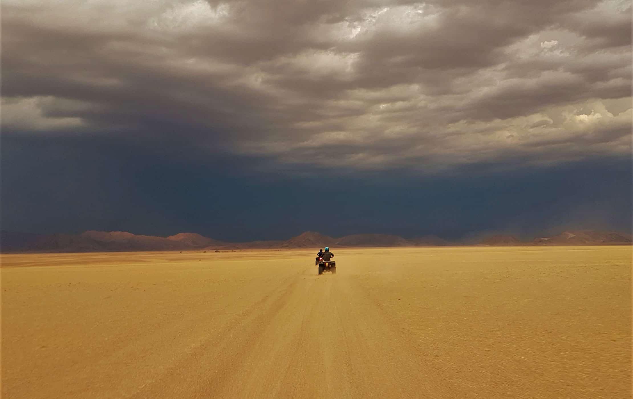 A car driving through the desert.