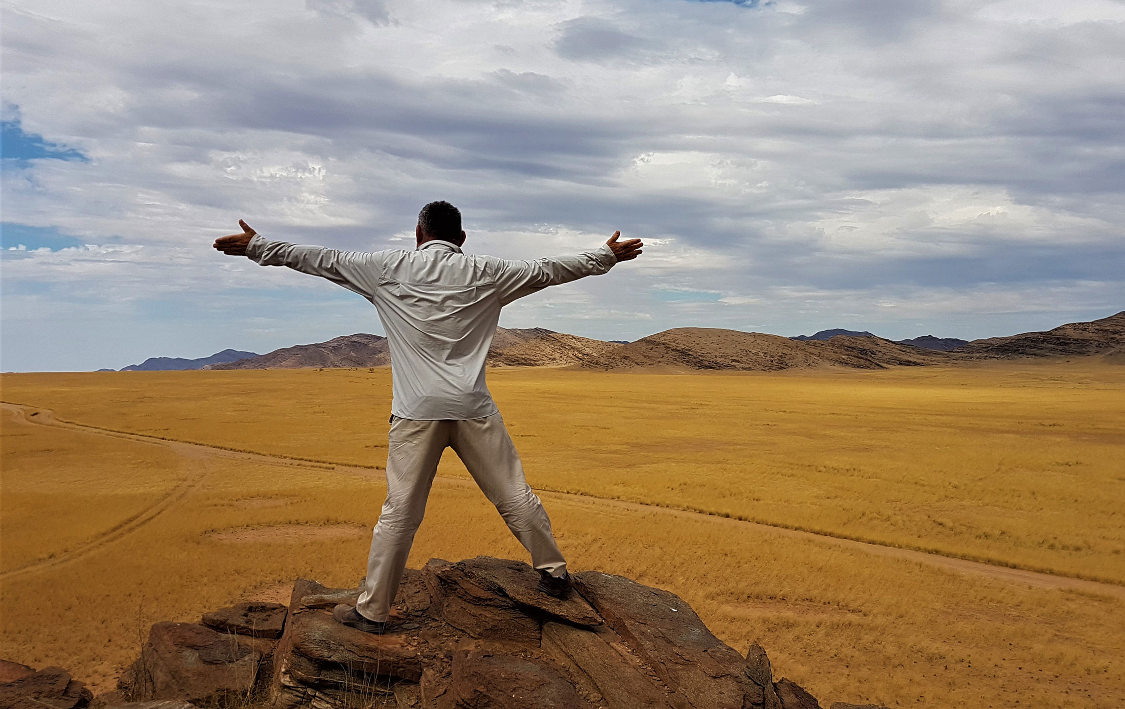 Man on top of a rock.