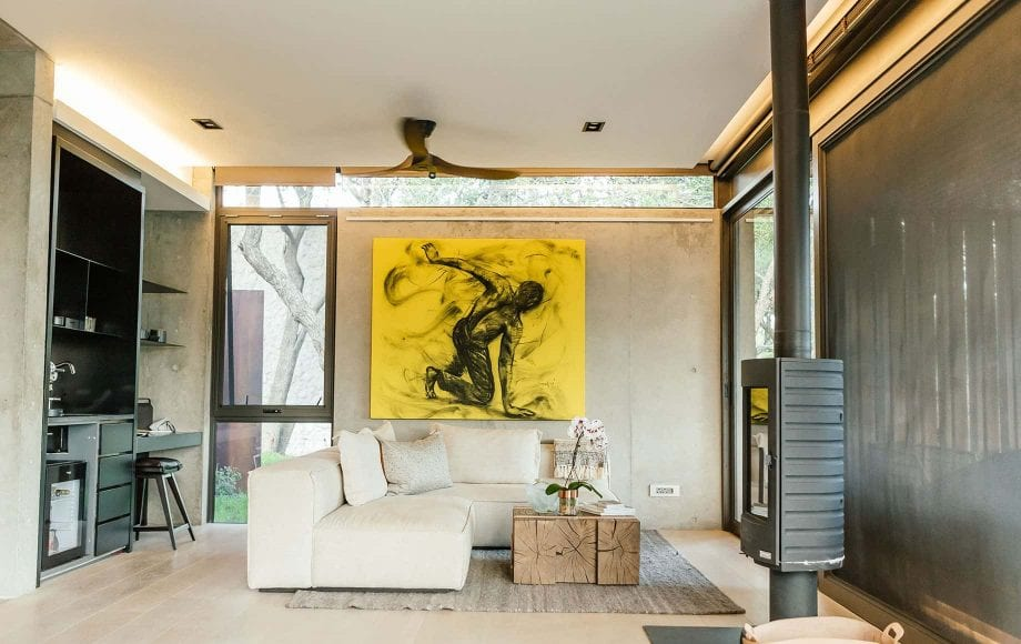 A living room with art and a fireplace
