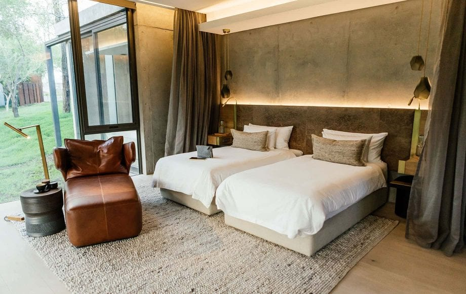 A bedroom with two full beds