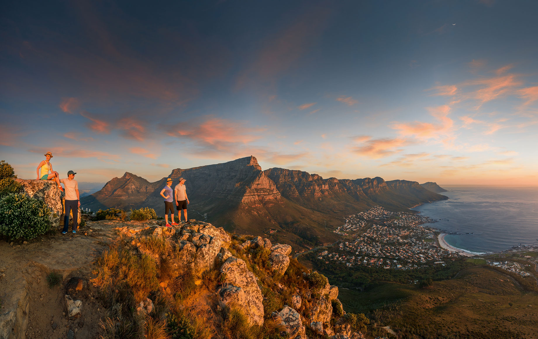 Two people standing on top of Table Mountain.