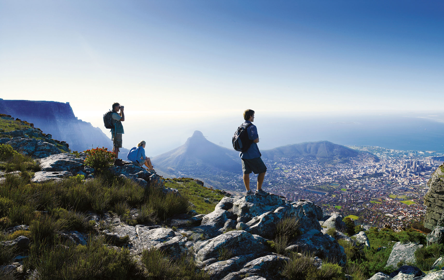A group of people standing on top of Table Mountain.