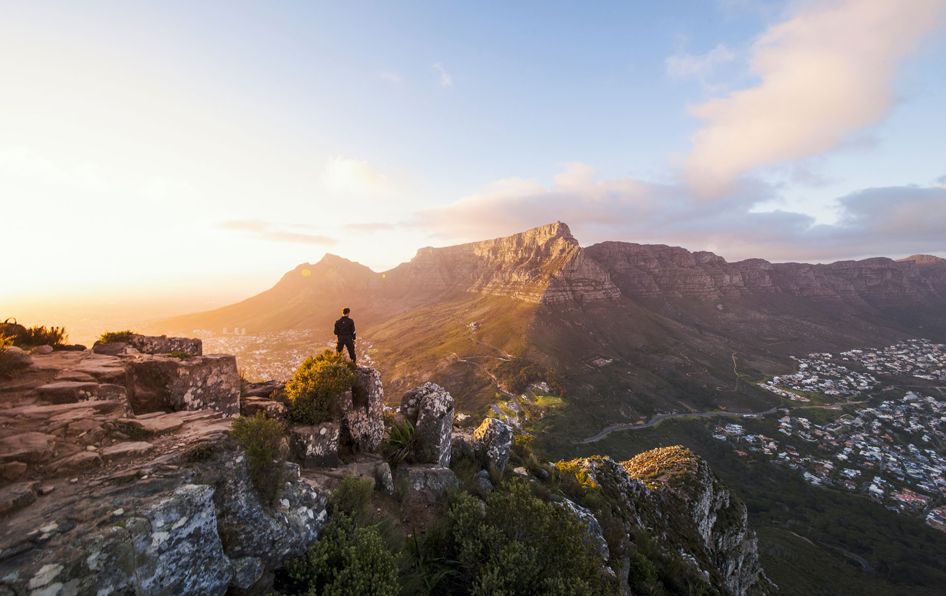 A man standing on top of Table Mountain.