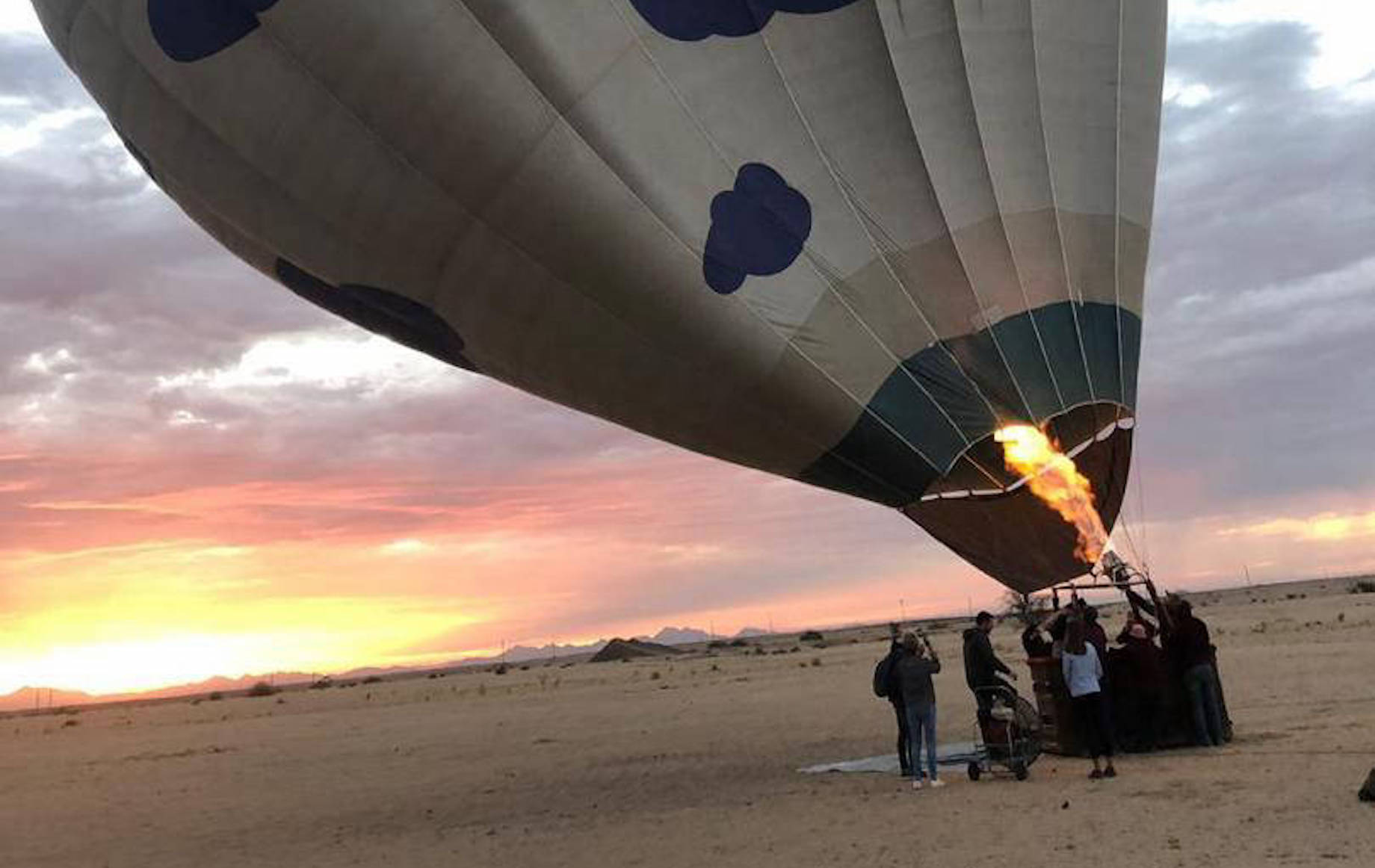 People trying to inflate hot air balloons