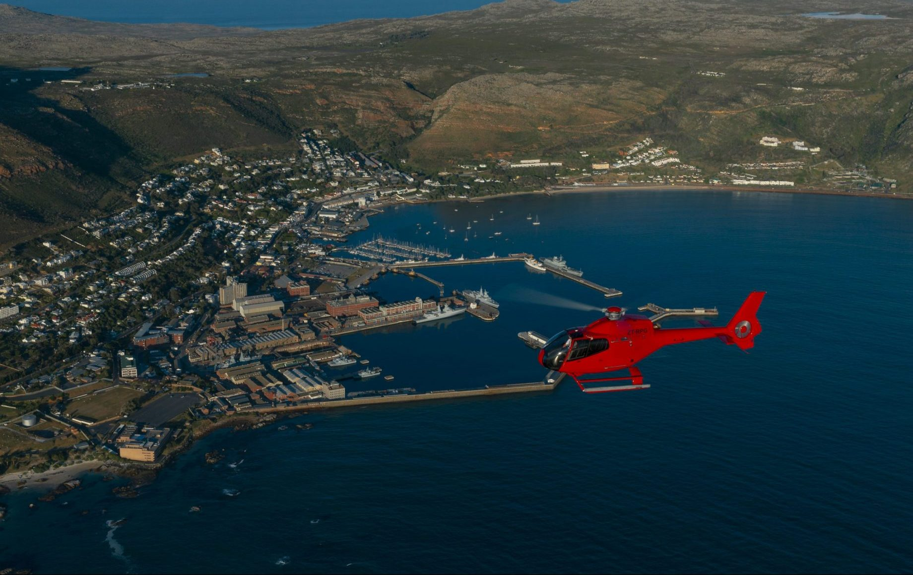 A helicopter hovering over the coast of cape town