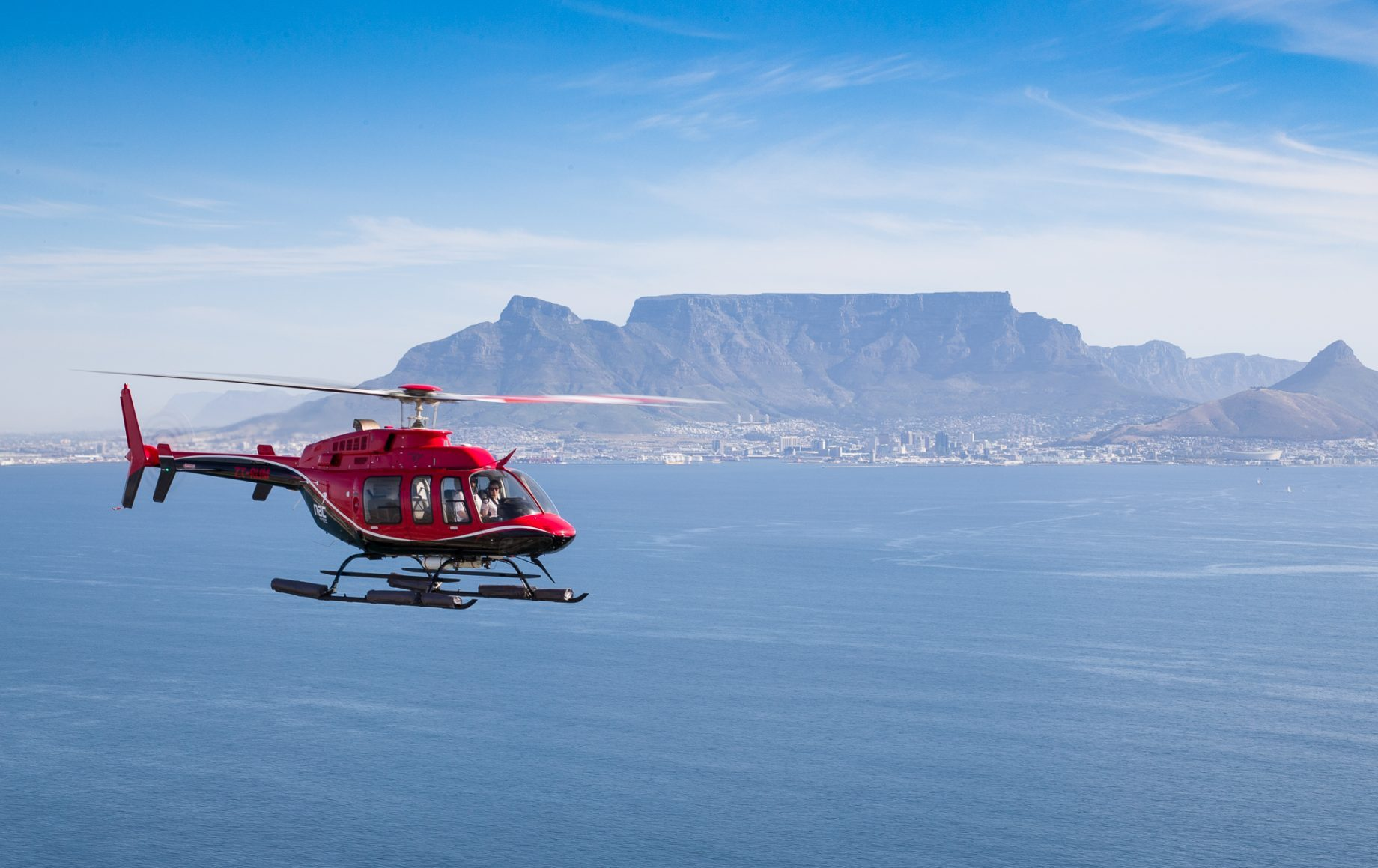 A helicopter over the ocean by Cape town