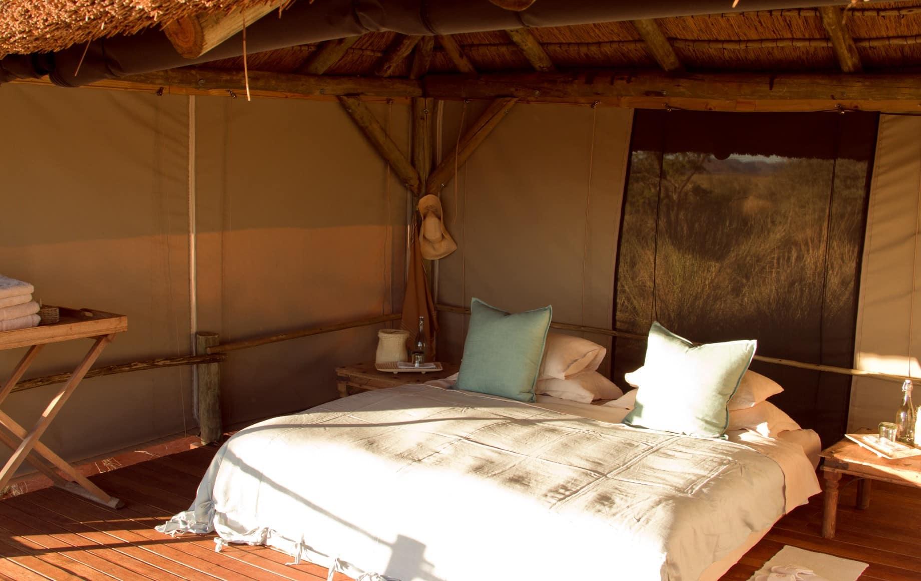 a bed facing the sun at Tswalu Motse