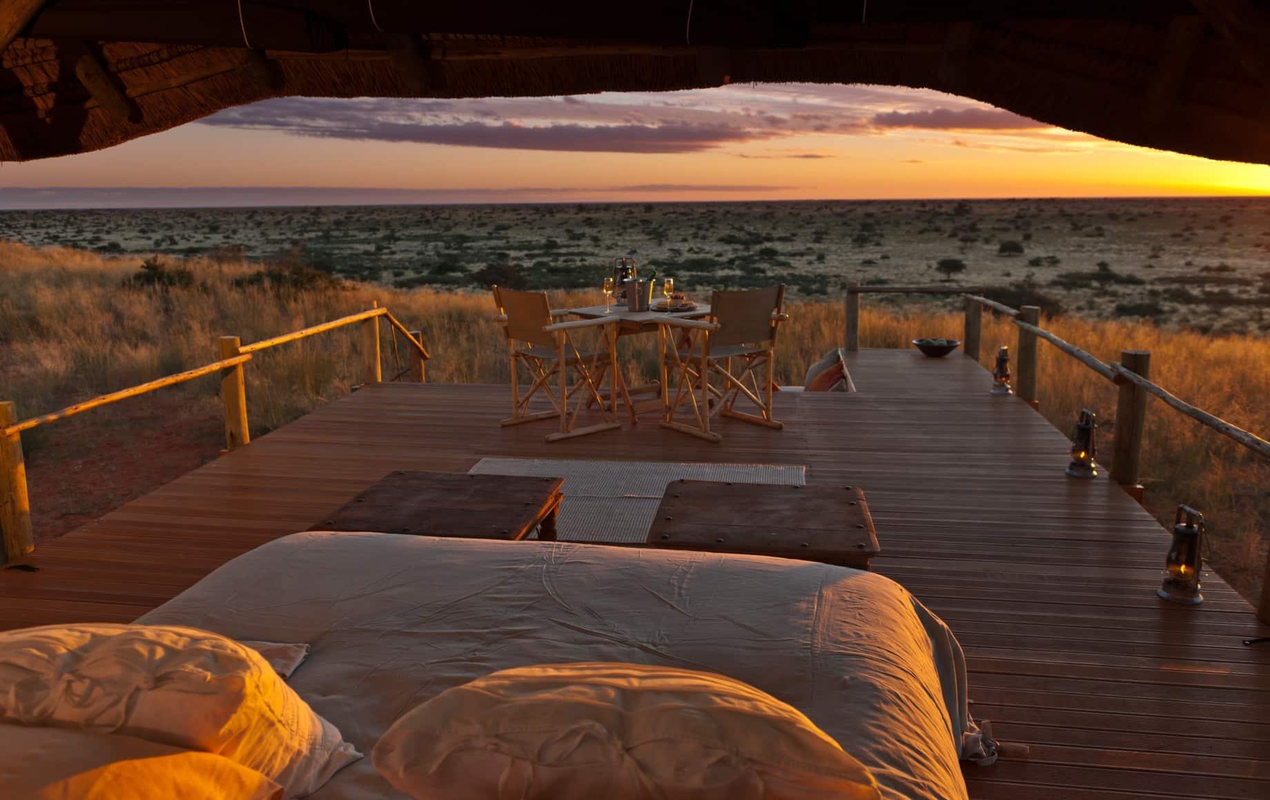 bed overlooking the savannah at sundown