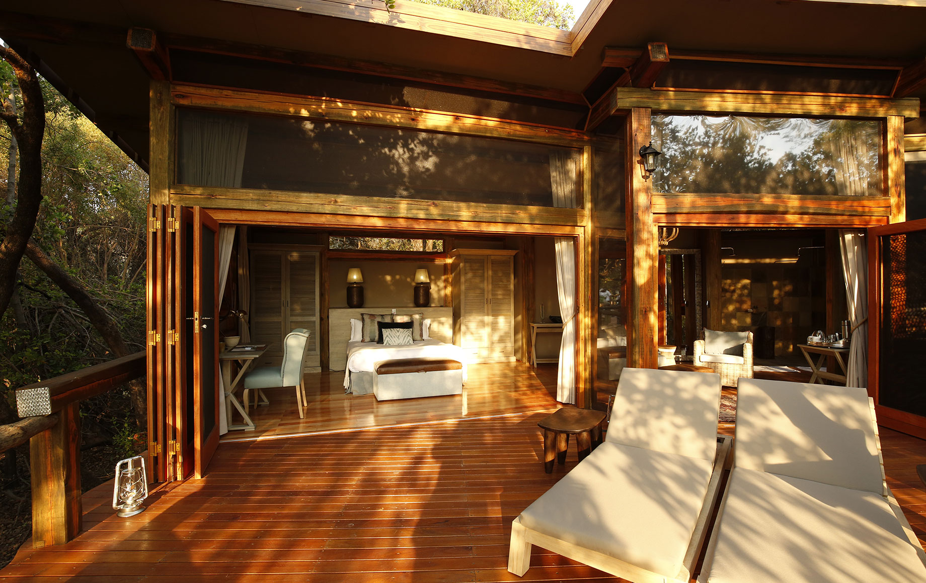 The view of a king bed from the deck at Camp Okavango