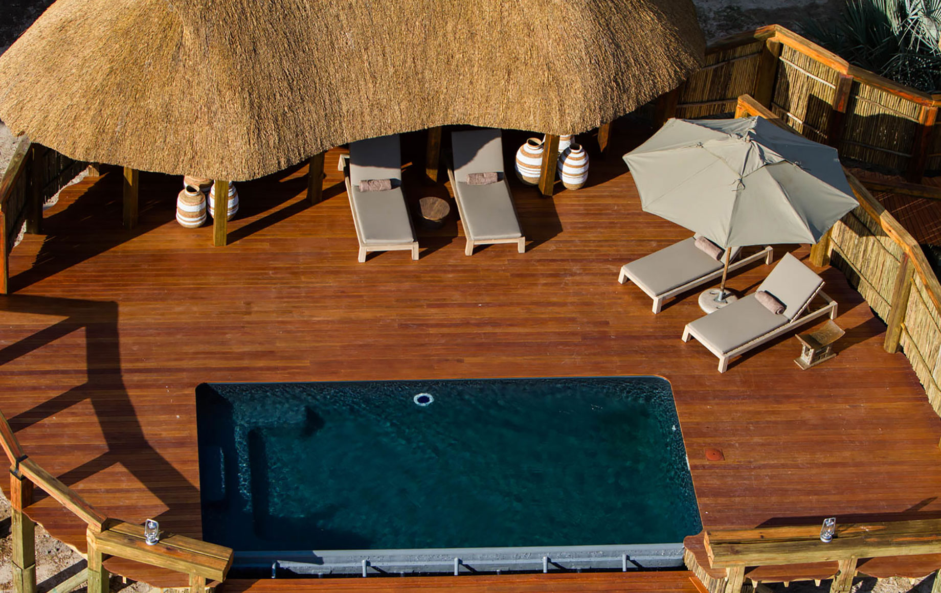 an aerial photo of a deck with a pool at Camp Okavango