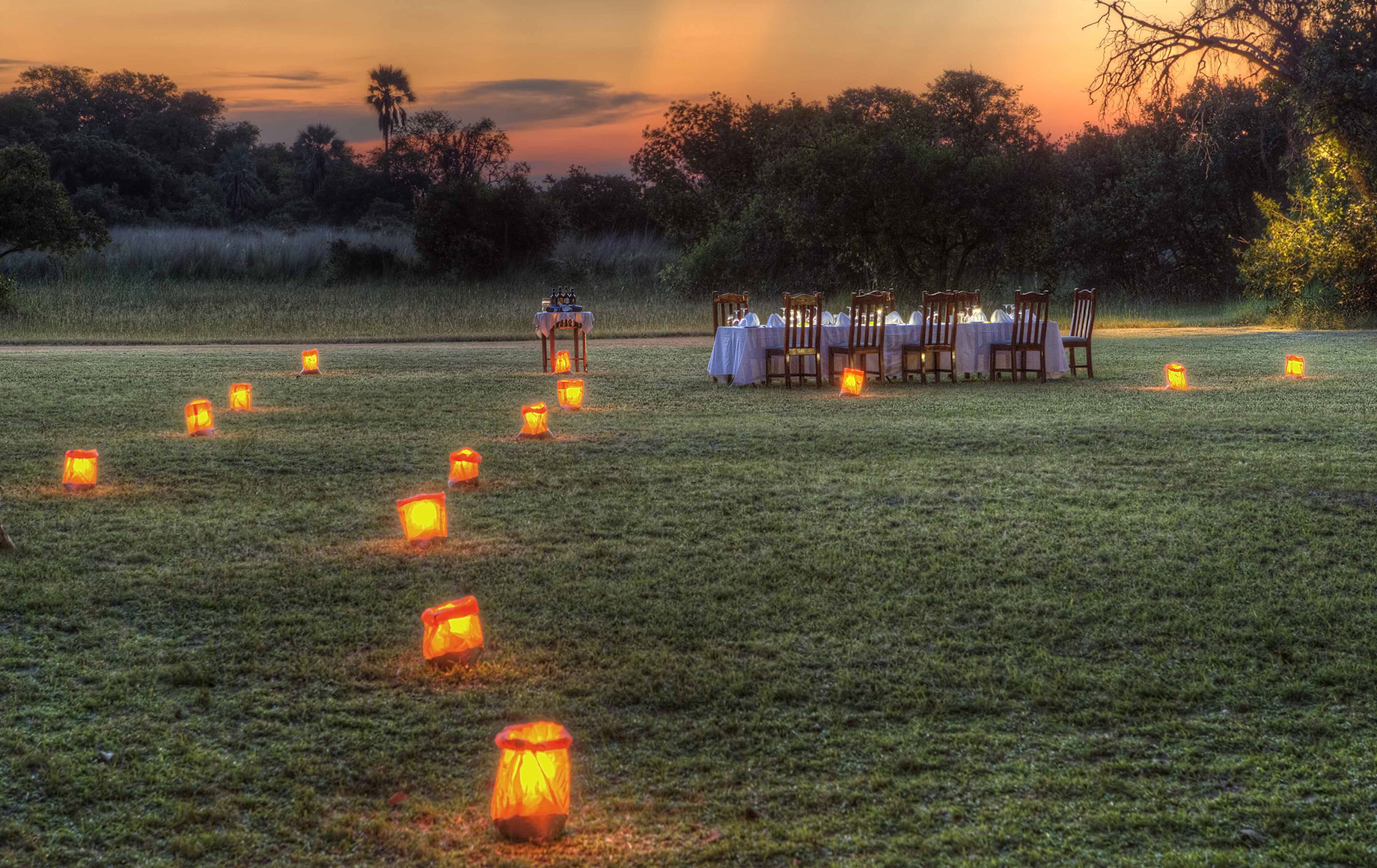 A path of candles leading to a dinner