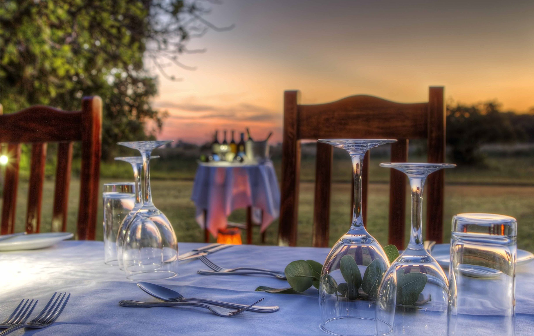Glasses on a table for a sunset dinner