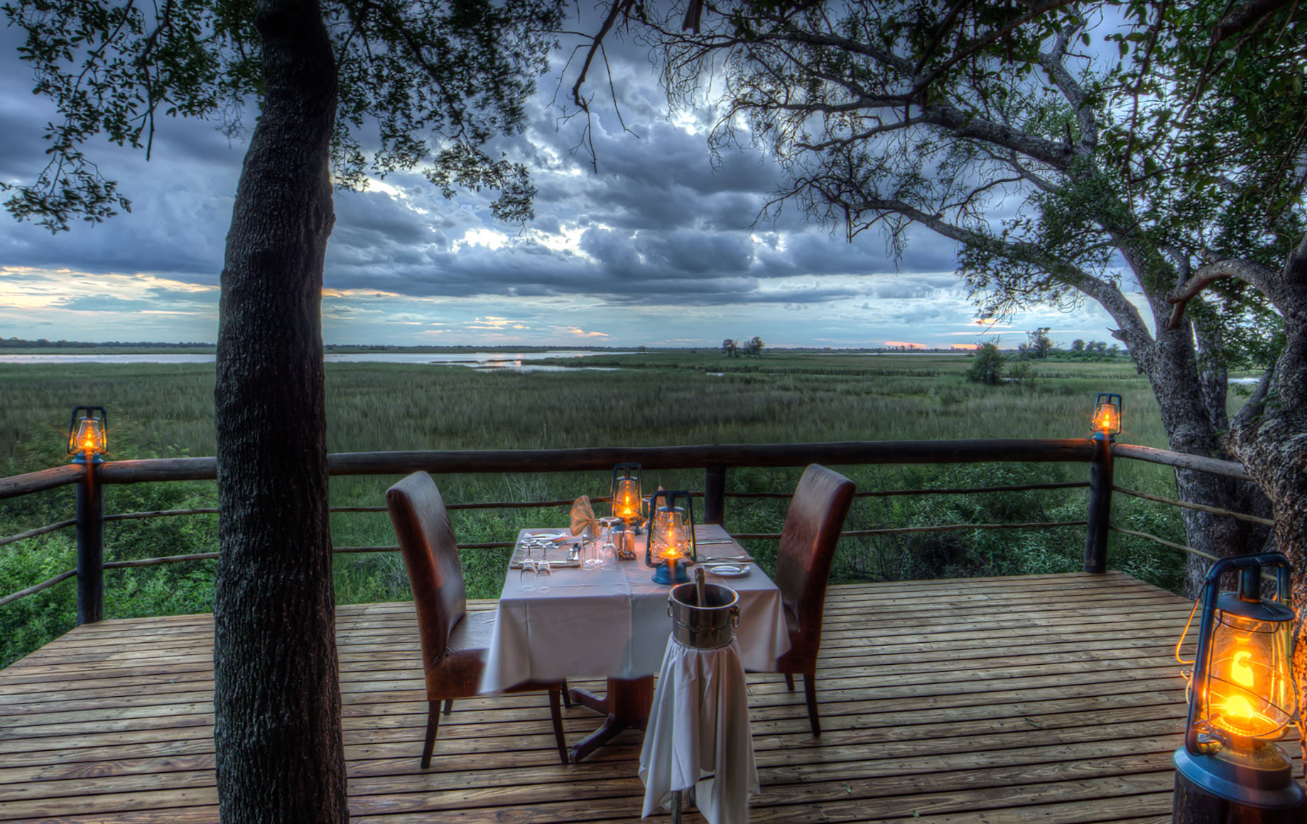 A dinner overlooking the forest at Camp Okavango
