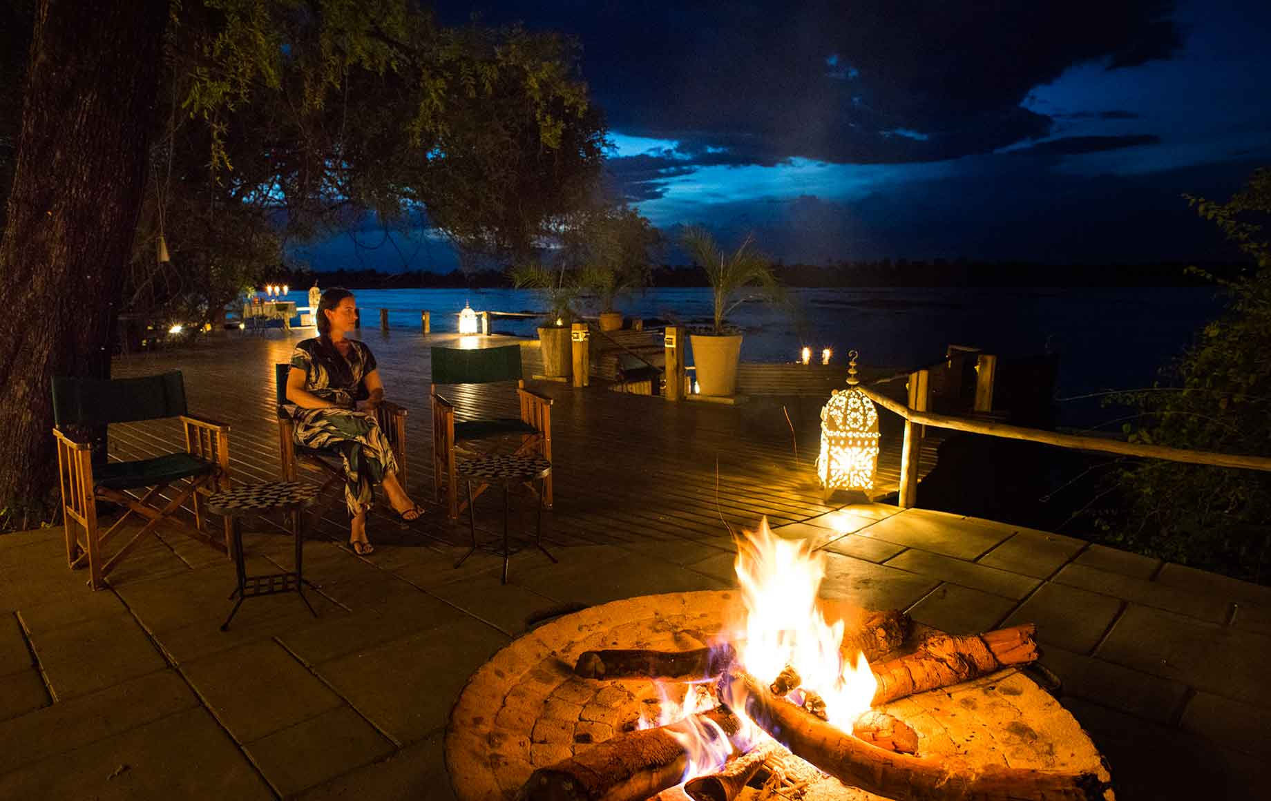 A guest enjoying a firepit at Camp Tongabezi