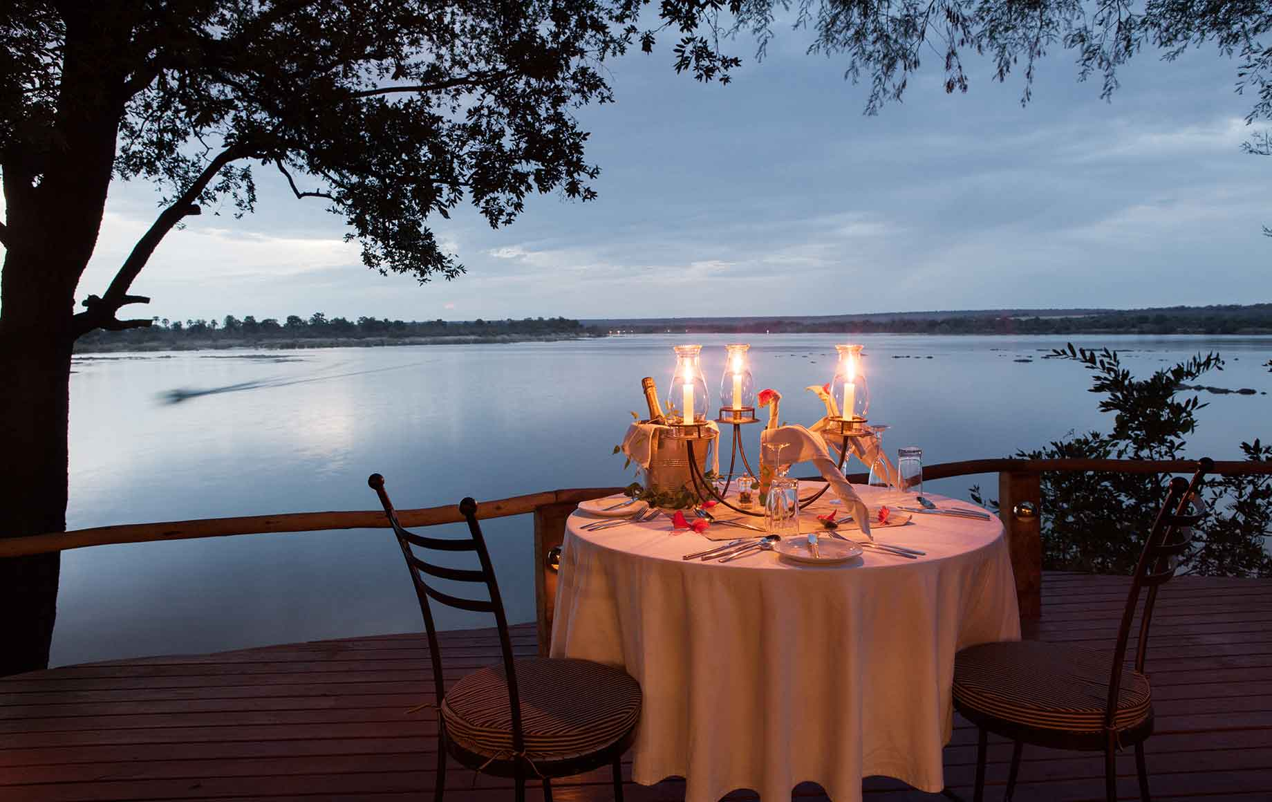 A candlelit dinner on the river at Camp Tongabezi