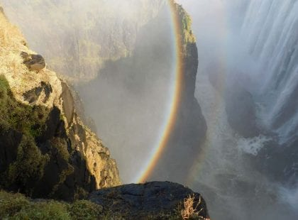 a rainbow in a waterfall