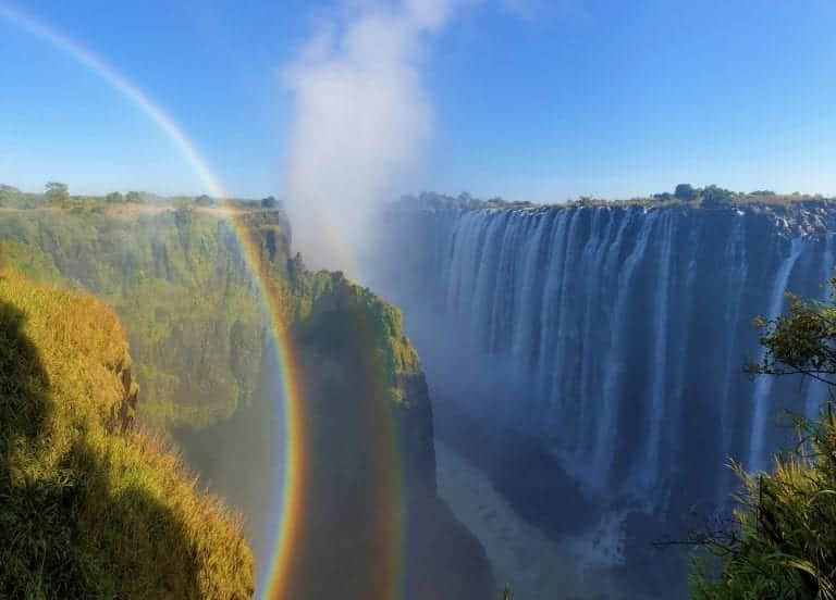 a rainbow at Victoria Falls