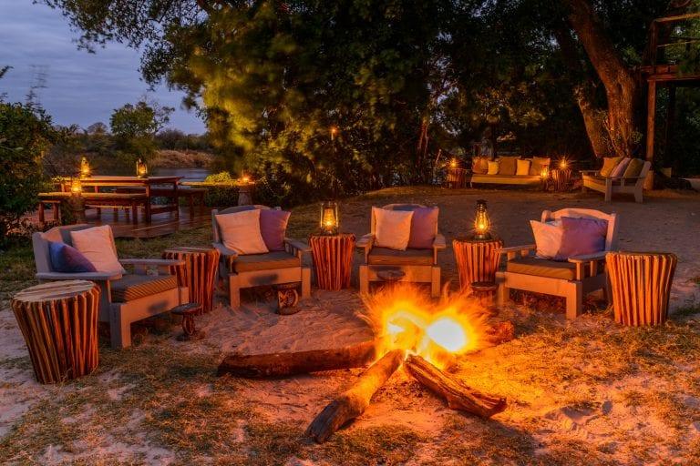 chairs arranged around a fire on Sindabezi Island