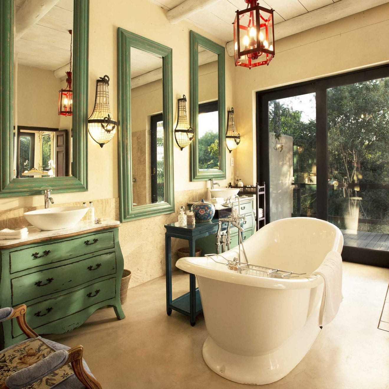 a marble bathroom with green accents