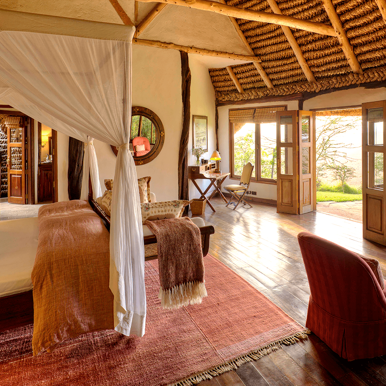 a bedroom looking out on the African bush