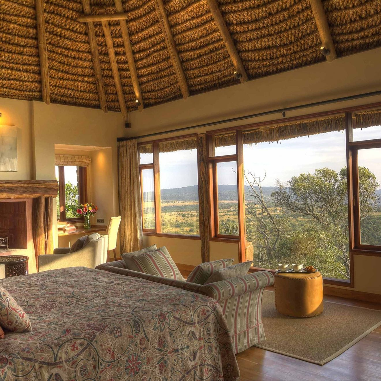 a bedroom at Laragai House with a large window overlooking the plains