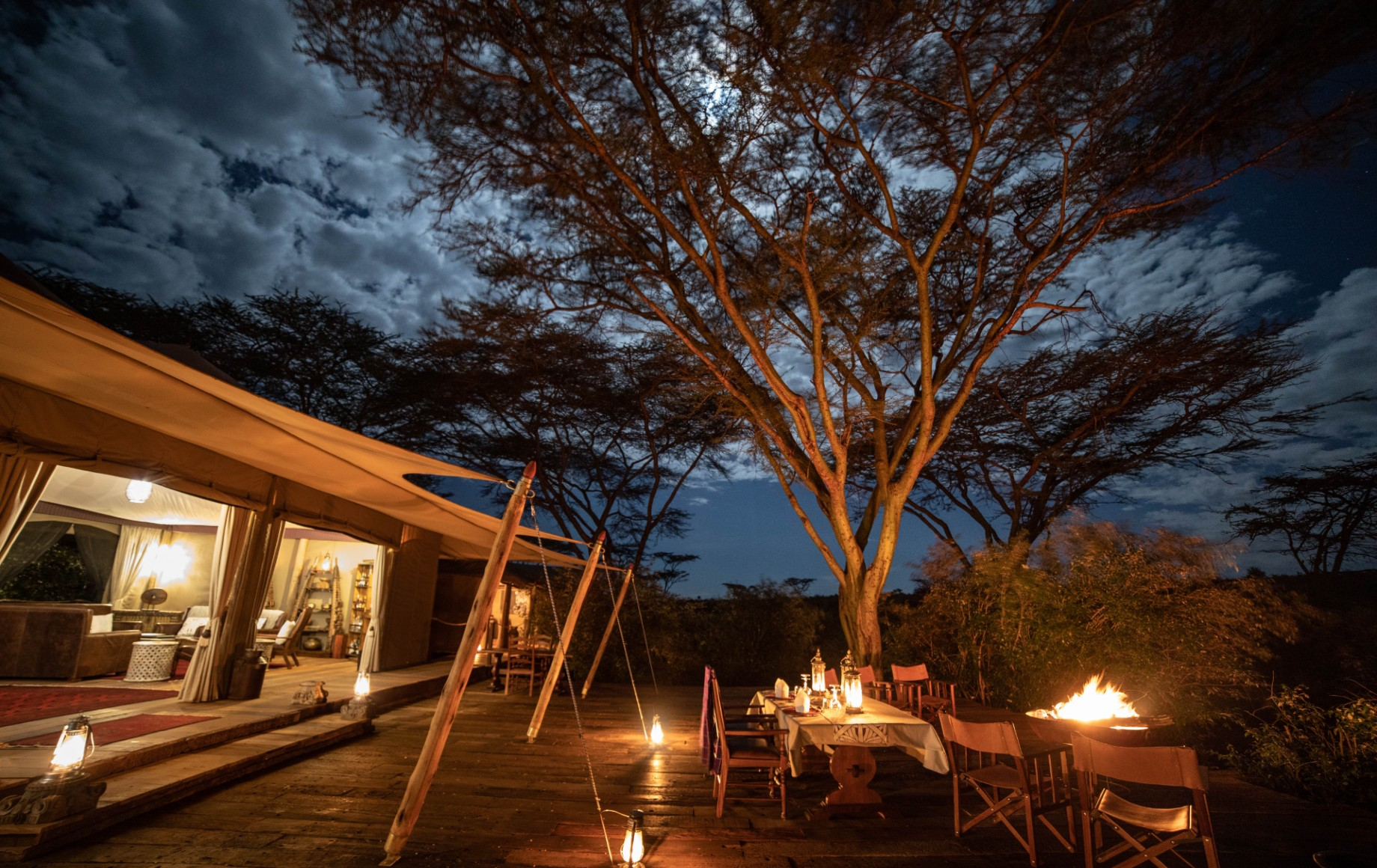 the lawn outside of a room at Mara Nyika at night