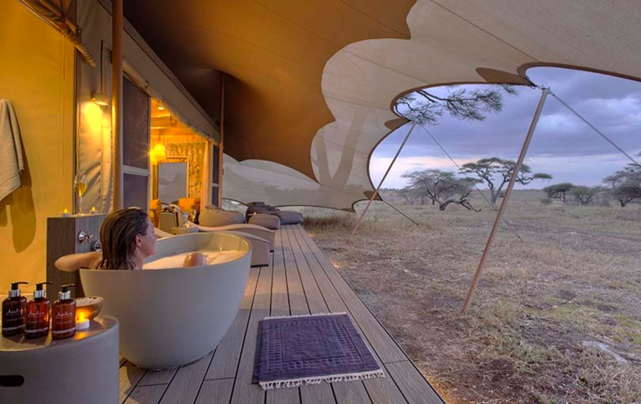 A deck outside a hotel room in Namiri Plains