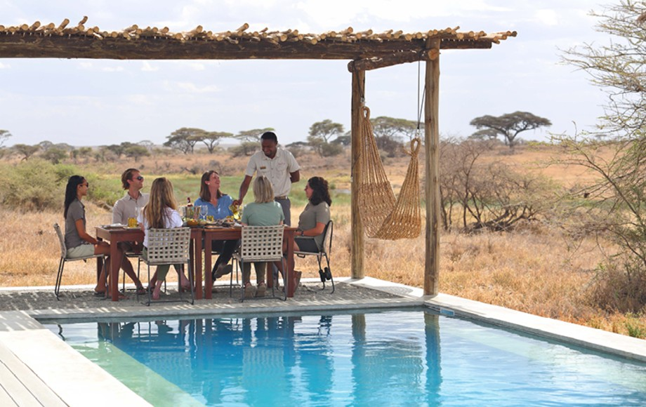 People by the pool at Namiri Plains