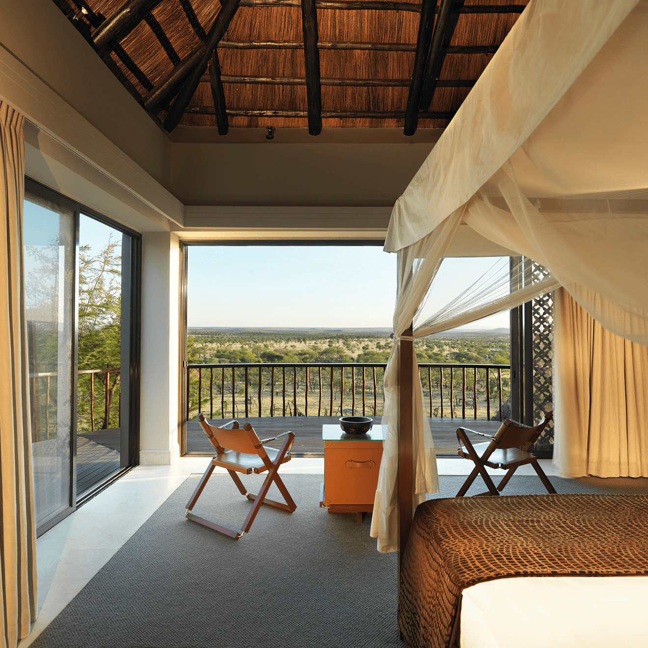 a bedroom balcony overlooking the Villas at the Four Seasons Serengeti
