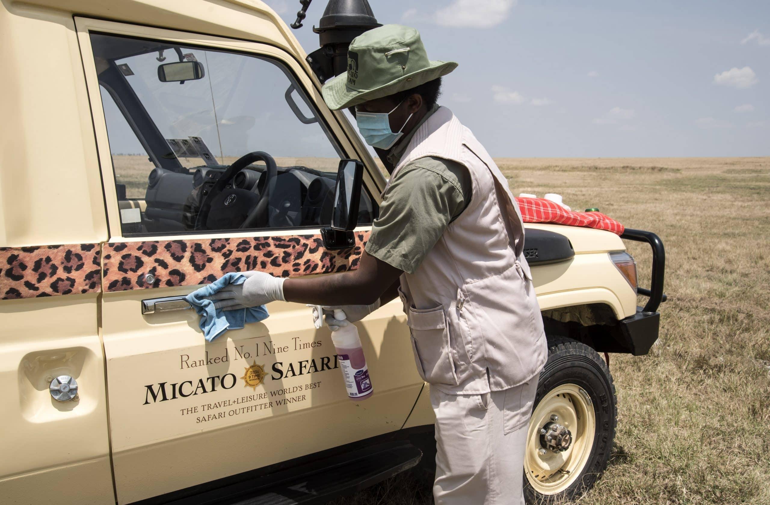 Micato Safari Director sanitizes vehicle