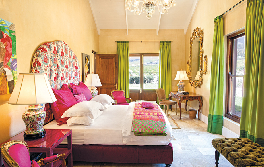 Guest bedroom with pink and green at La Residence