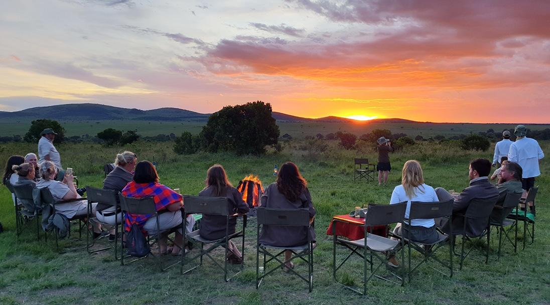 safari tour group viewing a sunset