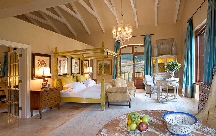 Guest bedroom with arch ceilings at La Residence