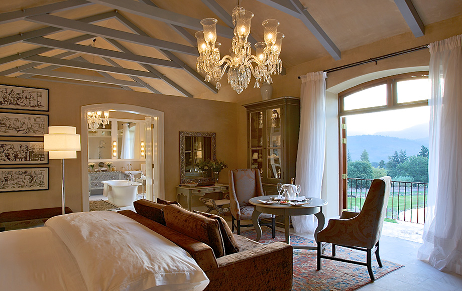 Guest bedroom with chandelier at La Residence