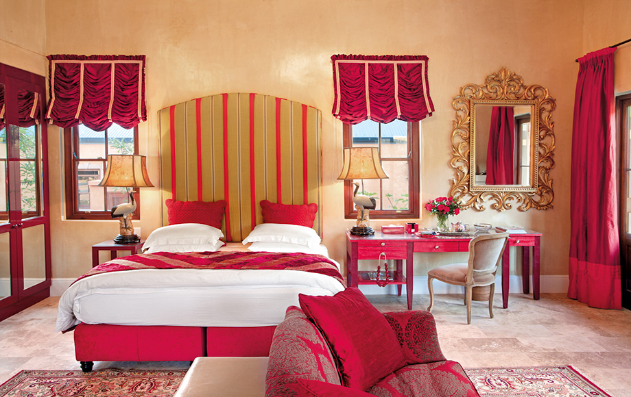 Guest bedroom with red accents at La Residence