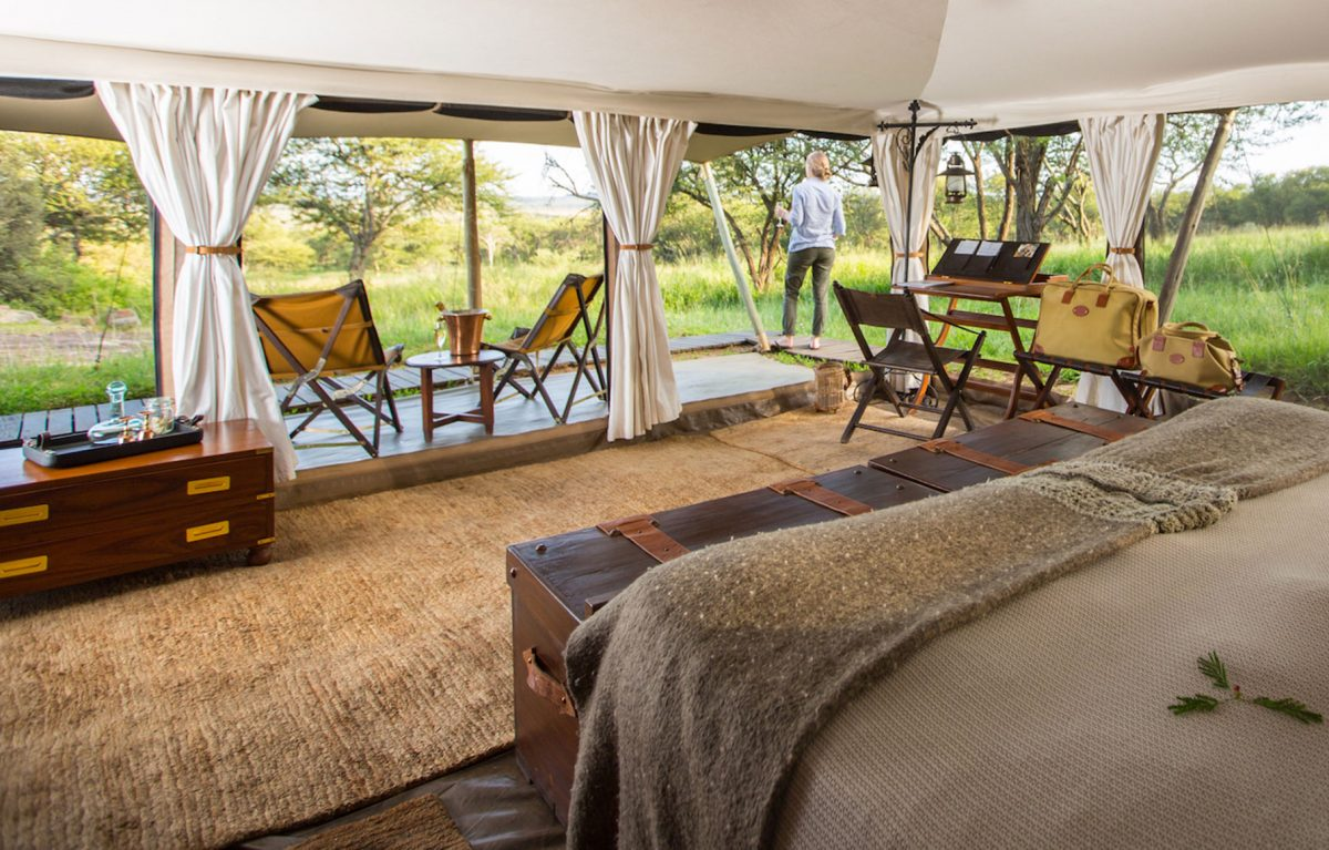 A woman admiring the view from the Serengeti Pioneer Camp.
