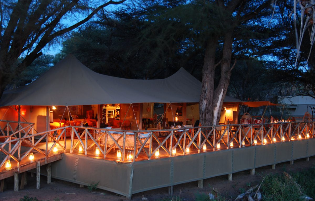 The Elephant Bedroom Camp lit at night by candles.