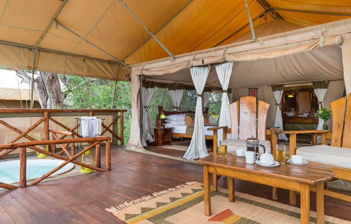 An interior view of the patio and bedroom at the Elephant Camp.