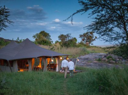 A couple walking back to the Serengeti Pioneer Camp.