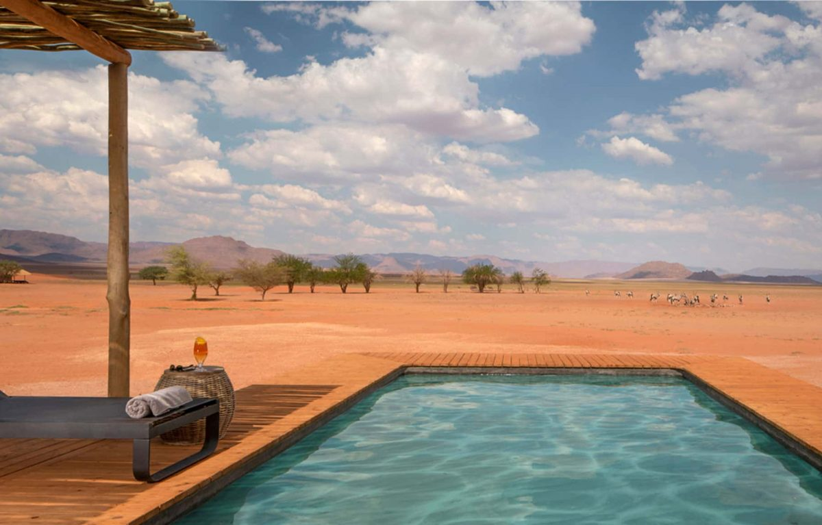 An outdoor pool that overlooks the open land.