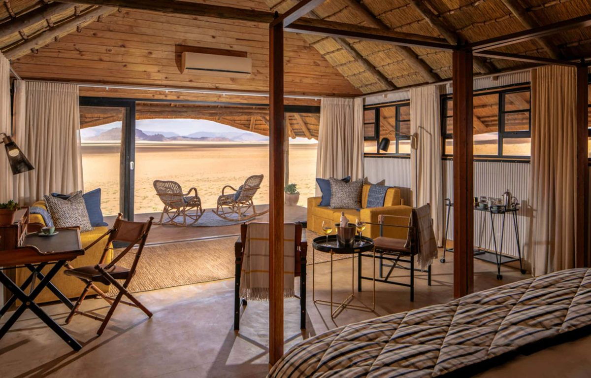 An interior view of the master bedroom and living room of the Kwessi Dunes.