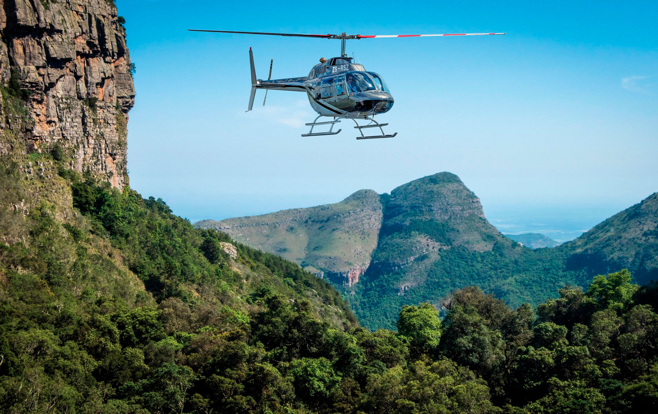 A helicopter flying over South Africa's Grandest Canyon
