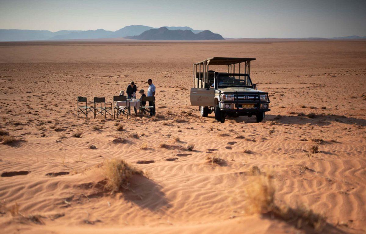 A couple enjoying a meal on their safari.